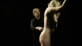 Bearded Master Disciplines Blonde Submissive With Paddle Whips And Wax
