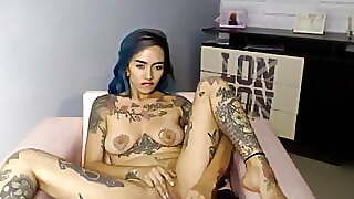 Suicide Girl Dildoing Her Shaved Pussy And Orgasming