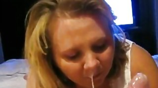 Devoted Wife Looking The Hubby In The Eyes While Giving A Blowjob