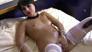 Stunning Babe In Fishnets Uses Some Sex Toys