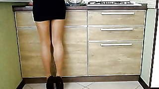 Heels Tights And Mini Skirt Cooking To Eat In The Kitchen