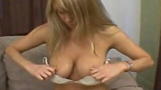 Big tit MILF makes herself cum on the bed