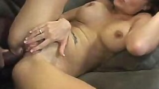 Horny MILF gets a gooey load on her face after being fucked by a black cock